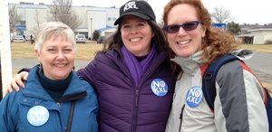 Eileen Flanagan is flanked by Amy Ward Brimmer (left) and Ingrid Lakey after her release in Washington, D.C. She was arrested during an act of civil disobedience outside the White House. All are members of the Earth Quaker Action Team, a Philadelphia group.